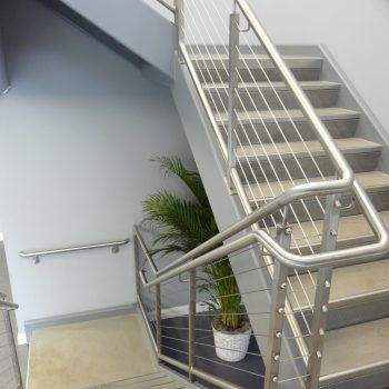 pan stairs with stainless steel hand railing with vertical stainless cables